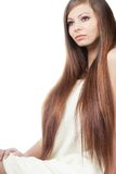 Woman portrait with long hair. Sitting woman portrait with long shiny hair over white Stock Photos