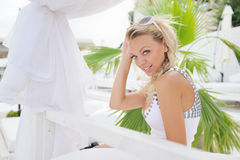 Woman portrait on a lounger in sea beach club. Stock Photo
