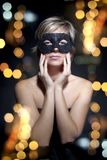 Woman portrait with mask and lights. Portrait of young woman with mask and lights on black  backgroun Royalty Free Stock Photos