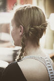Woman portrait with modern style braid in hair. At hair studio Royalty Free Stock Photography