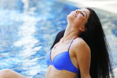Woman portrait near pool Royalty Free Stock Photos