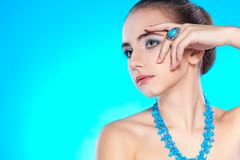 Woman portrait with necklace and ring on finger Royalty Free Stock Photo