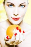 Woman Portrait offer an orange smiling Stock Photo