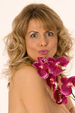 Woman portrait with orchid and kiss Stock Photo