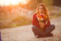 Woman portrait outdoor in sunset light. Stock Photos