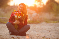 Woman portrait outdoor in sunset light. Royalty Free Stock Photos