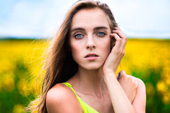 Woman portrait outdoors on the flower field Royalty Free Stock Photos