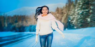 Woman portrait outdoors on snowy white winter day. Stock Images