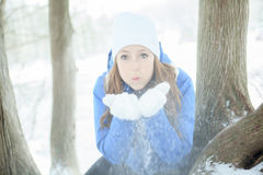 A woman portrait outside in winter season Stock Photos