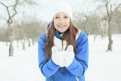 A woman portrait outside in winter season Stock Photo