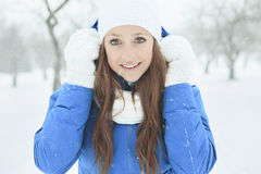 A woman portrait outside in winter season Stock Images