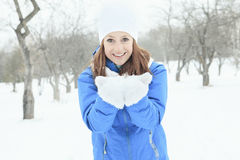 A woman portrait outside in winter season Stock Images