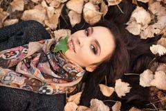 Woman portrait over autumn leaves close up Stock Photos
