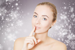 Woman portrait over background with snowflakes. Beautiful woman face portrait with snowflakes Royalty Free Stock Photo