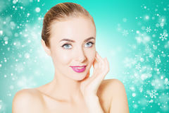 Woman portrait over background with snowflakes. Beautiful woman face portrait with snowflakes Stock Photography