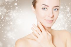 Woman portrait over background with snowflakes. Beautiful woman face portrait with snowflakes Stock Image