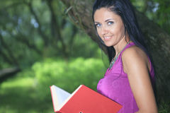 Woman portrait over a green nature background Stock Image
