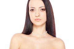 Woman portrait over white with pearl necklace Stock Photography