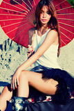 Woman portrait with parasol. Red hair woman portrait in desert with parasol Stock Photography
