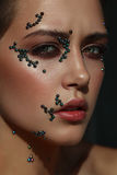 Woman portrait with pearl beads on her skin. Creative makeup Royalty Free Stock Photos