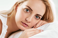 Woman portrait on pillows. close Stock Images