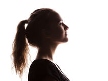 Woman portrait profile in silhouette shadow. On studio isolated white background royalty free stock image