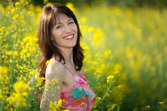Woman portrait in rape field Stock Photography