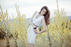 Woman portrait in rapeseed field Royalty Free Stock Photo