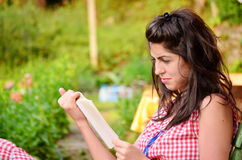 Woman portrait reading a book Stock Image