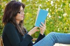 Woman portrait reading a book Stock Images