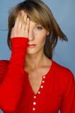 Woman portrait with red blouse. Blond woman portrait with red blouse Royalty Free Stock Image
