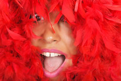 Woman portrait  in red feather Royalty Free Stock Photography