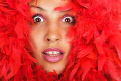 Woman portrait  in red feather Royalty Free Stock Image