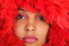 Woman portrait  in red feather Royalty Free Stock Images