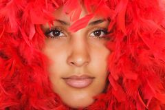 Woman portrait  in red feather Stock Photos