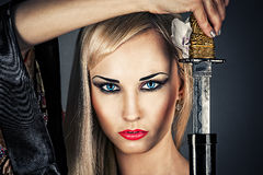 Woman portrait with a samurai sword. Beautiful woman portrait with a samurai sword Royalty Free Stock Photos