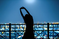 Woman portrait in silhouette in night city background Stock Photo