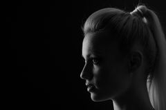 Woman portrait silhuette in darkness with soft light on face. Stock Images
