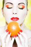Woman portrait smell orange fruit Royalty Free Stock Image