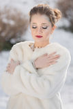 Woman Portrait, Snow Queen. Winter portrait of a young pretty woman Stock Images