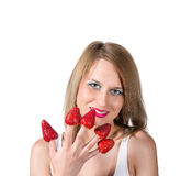 Woman portrait and strawberry on a her fingers Royalty Free Stock Photo