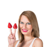 Woman portrait and strawberry on a her fingers Stock Photography