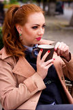 Woman portrait in the street cafe with cup of tea Royalty Free Stock Photography
