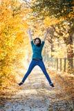 Woman portrait sun park jump Royalty Free Stock Photos