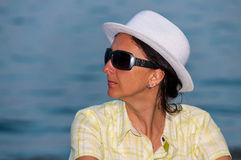 Woman portrait sunglasses white hat Royalty Free Stock Image