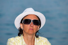 Woman portrait sunglasses white hat Stock Images