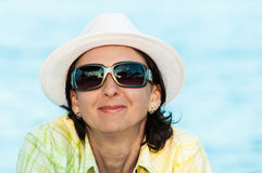 Woman portrait sunglasses white hat Stock Photo