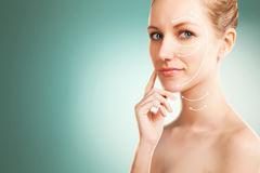 Woman portrait with surgery lines, blue   gradient background Stock Photography
