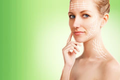 Woman portrait with surgery lines,  green gradient background Stock Photography