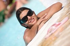 Woman portrait in a swimming pool Stock Photography